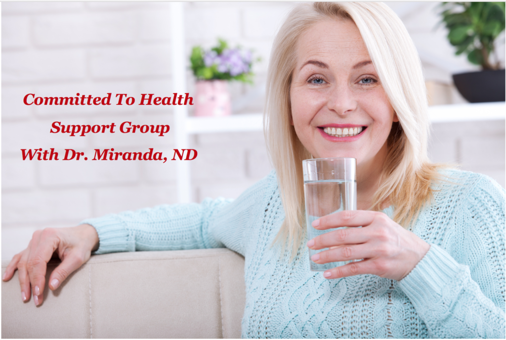 lady happy with glass of water